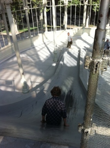 Bill slides down a giant slide inside the Crystal Palace.