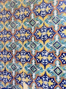 Blue, yellow, and green tiles create a repeating pattern